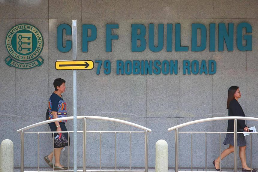 Pedestrians outside the former CPF Building at 79 Robinson Road.