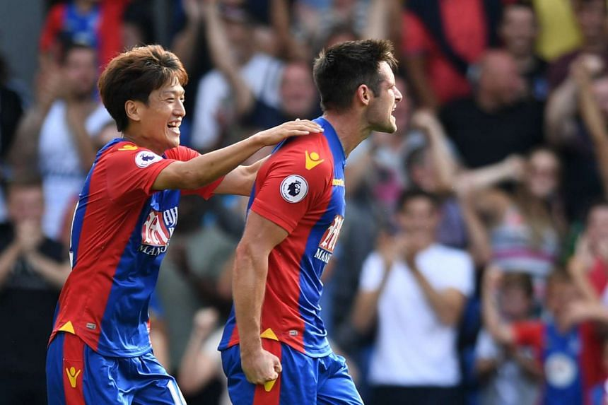 Crystal Palace's Scott Dann celebrates scoring their first goal with Lee Chung-yong.