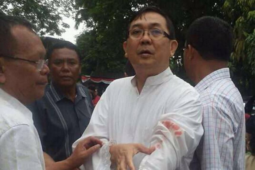 Indonesian pastor Albert Pandiangan was slightly wounded in the suspected terror attack in his church in Medan, on Aug 28, 2016.
