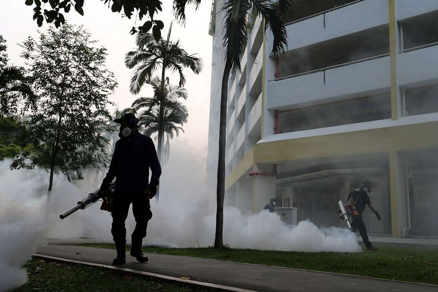 NEA officers conducting a fogging operation in Aljunied Crescent on Aug 28, 2016.