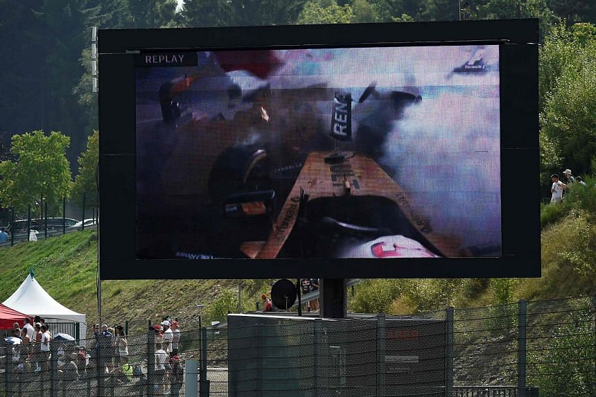 A giant display screen showing the moment Renault driver Kevin Magnussen crashed during the Belgian Formula One Grand Prix at the Spa-Francorchamps circuit, on Aug 28, 2016.