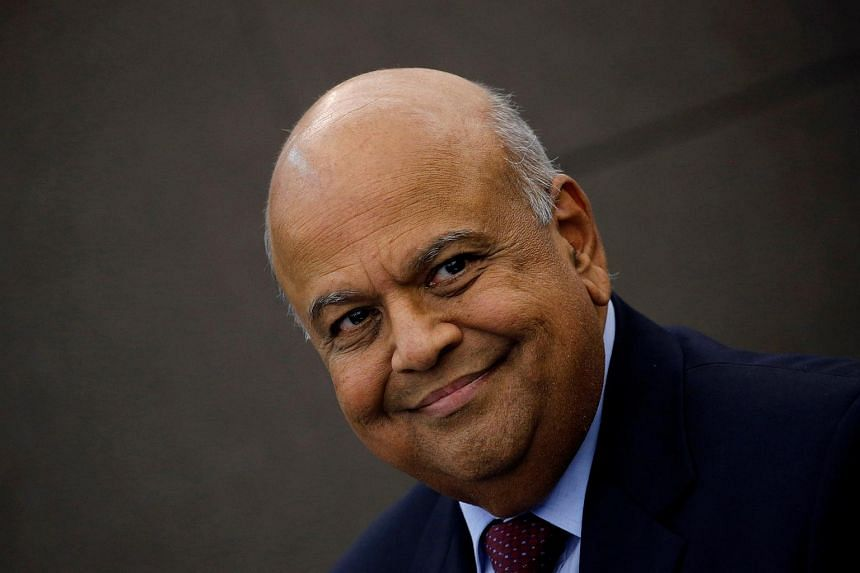 South African Finance Minister Pravin Gordhan looks on during a media briefing in Sandton near Johannesburg, South Africa, on March 14, 2016.