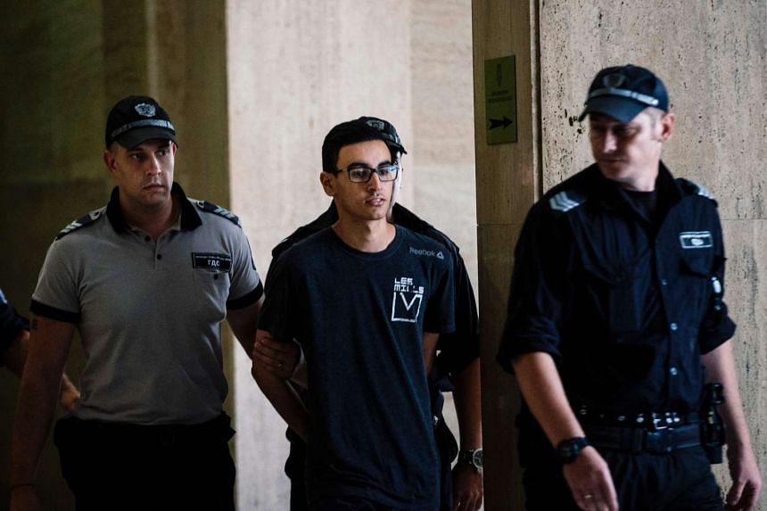 Mourad Hamyd is escorted by police officers as he arrives at a court in Sofia, Bulgaria, on Aug 10, 2016.