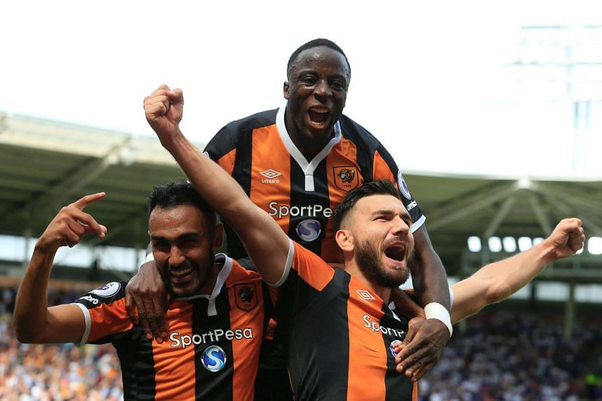 Hull players (from left) Ahmed Elmohamady,  Adama Diomande and Robert Snodgrass celebrate a goal against Leicester on Aug 13, 2016.