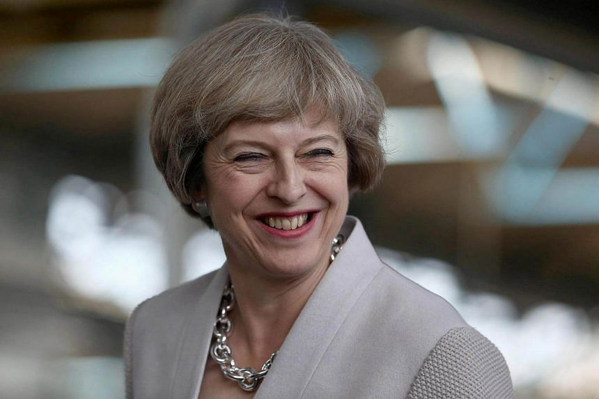 Britain's Prime Minister Theresa May visits a joinery factory in London on Aug 3.