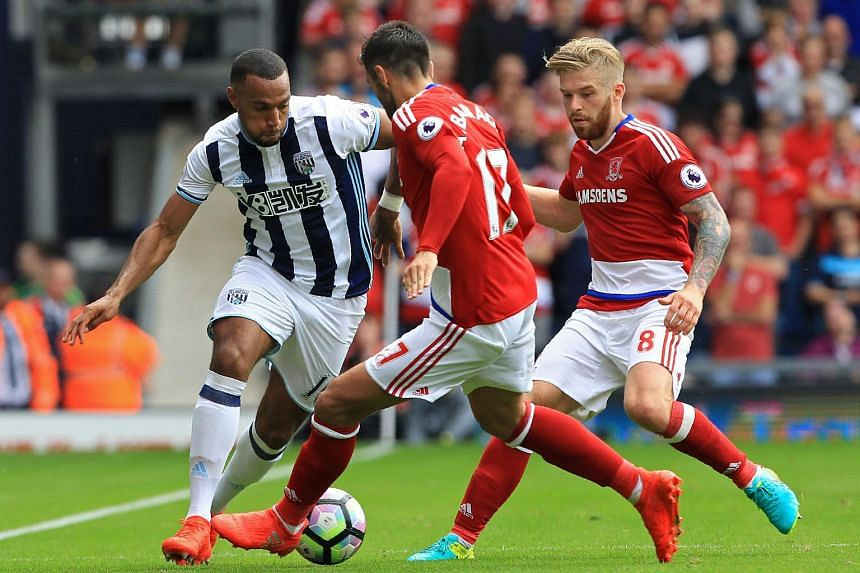 West Bromwich Albion's Matt Phillips (left) tussles for the ball with Middlesbrough's Antonio Barragan (centre) and Adam Clayton during the EPL match on Aug 28, 2016.