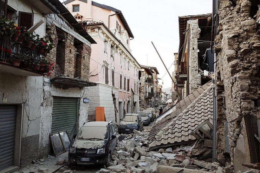 Rescue workers in Accumoli, Rieti Italy on August 26, two days after the powerful earthquake that killed at least 250 people.