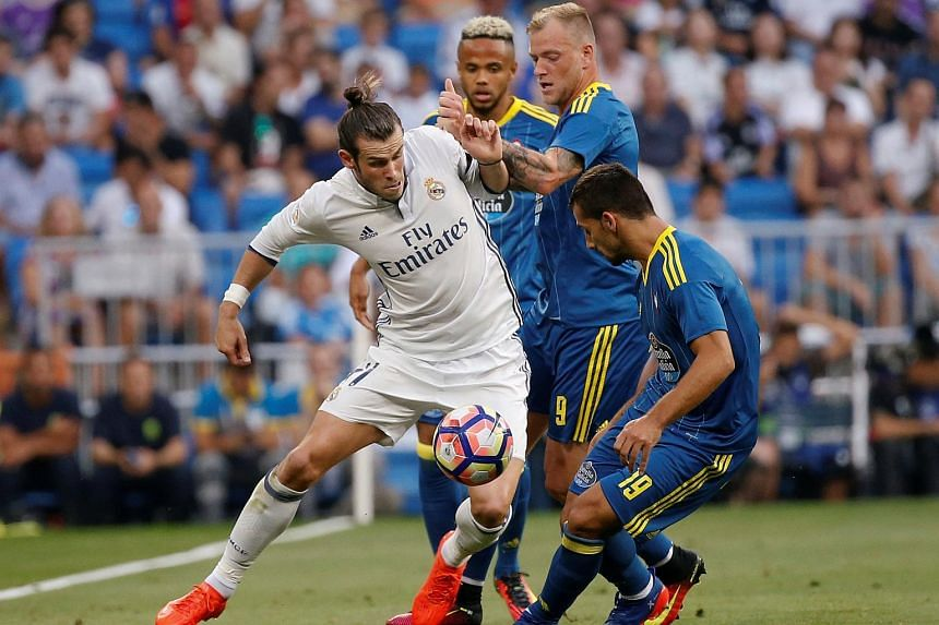 Real Madrid's Gareth Bale and Celta Vigo's Theo Bongonda (left), John Guidetti and Jonny Castro (right) in action on Aug 27, 2016.