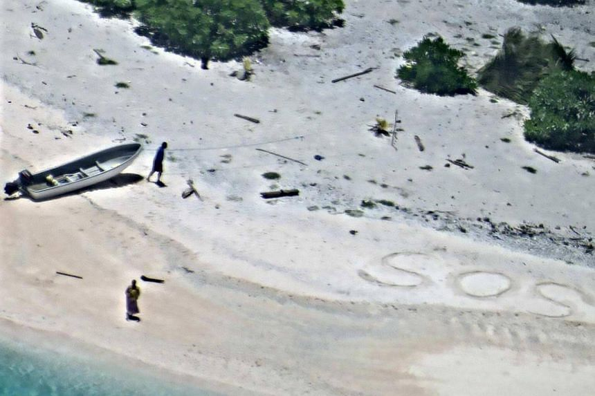 A couple stranded on a remote Pacific island have been rescued after a search aircraft spotted their SOS message in the sand, the US Coast Guard said on Aug 28.