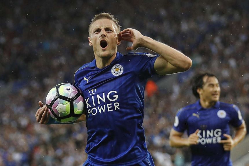 Leicester City's Jamie Vardy celebrates scoring their first goal.