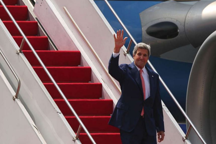 US Secretary of State John Kerry gestures as he arrives at Dhaka airport on Aug 29, 2016.