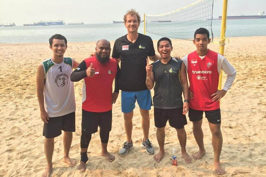 Former Arsenal goalkeeper Jens Lehmann (middle) posing for a picture with fans in Singapore. He is in Singapore to promote the German Bundesliga.