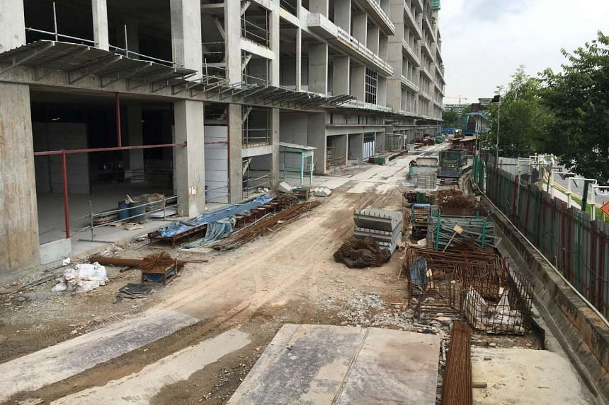 The Mega@Woodlands construction site run by Wee Hur Construction at Woodlands Close and Woodlands Ave 12.