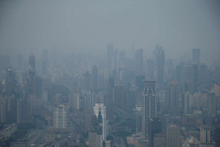 Heavy smog blanketing Shanghai's Puxi district on July 28, 2016.