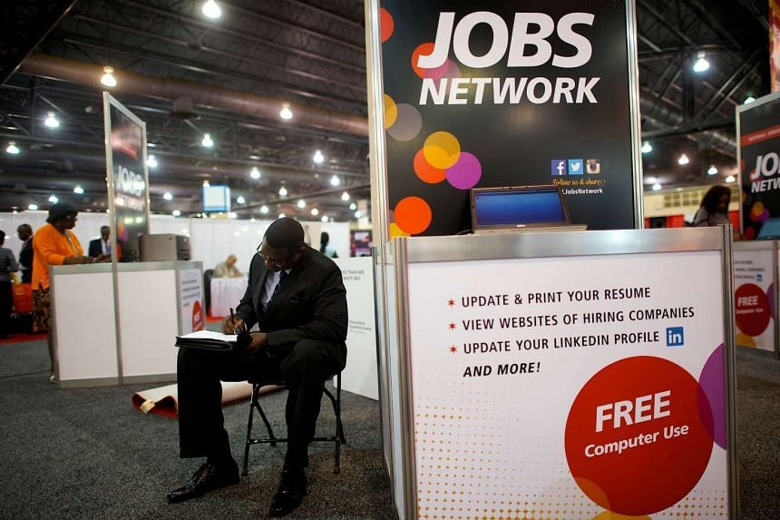 A job-seeker completing an application at a career fair in Philadelphia on July 25, 2013.