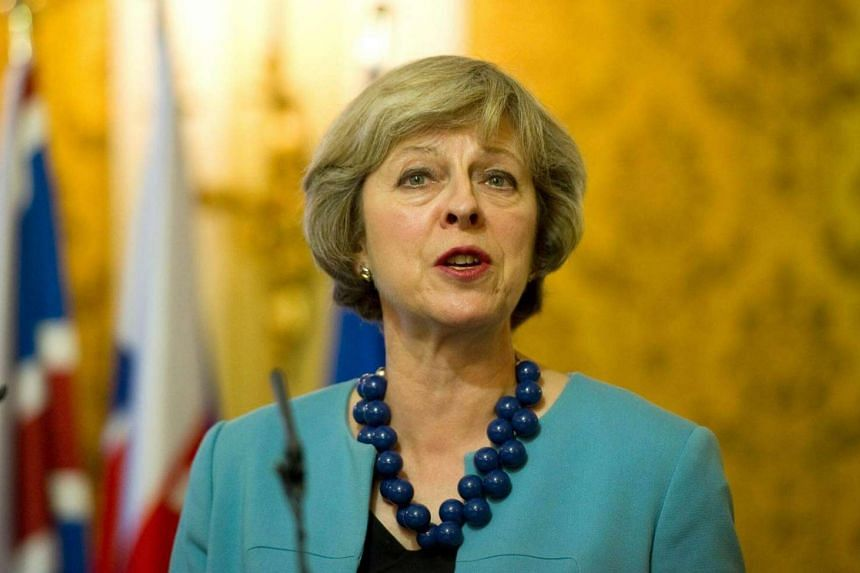 British Prime Minister Theresa May speaks at a press conference after meeting Slovak Prime Minister Robert Fico in Bratislava on July 28.