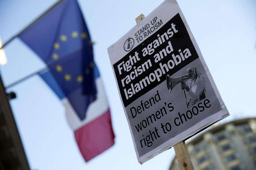 A placard held by a demonstrator at a protest organised by Stand up to Racism outside the French Embassy in London on Aug 26 against the burkini ban on French beaches.