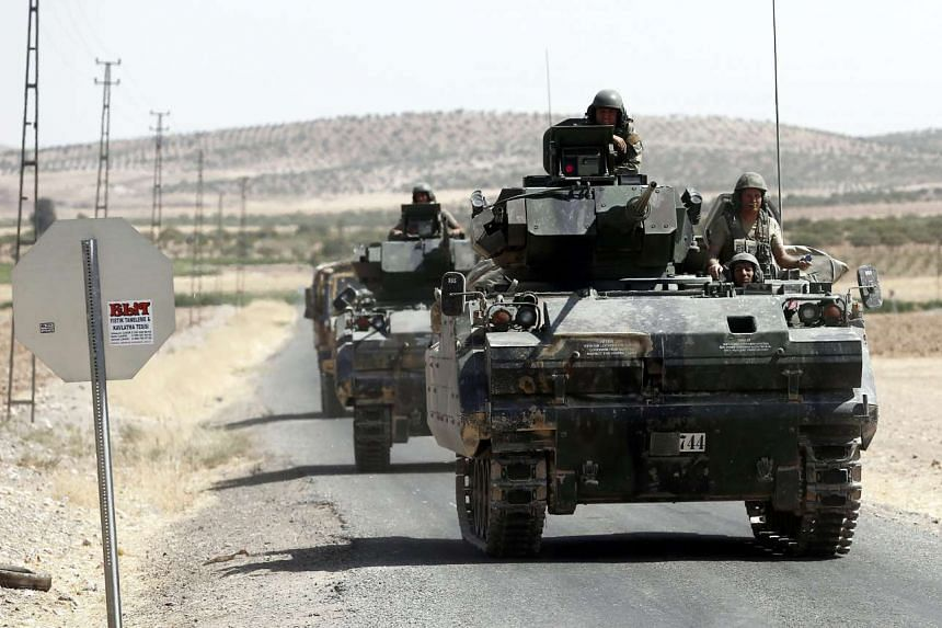 Turkish soldiers with tanks return from Syria to Turkey after a military operation at the Syrian border as part of their offensive against the Islamic State in Iraq and Syria (ISIS) militant group in Syria, Karkamis district of Gaziantep, Turkey, on