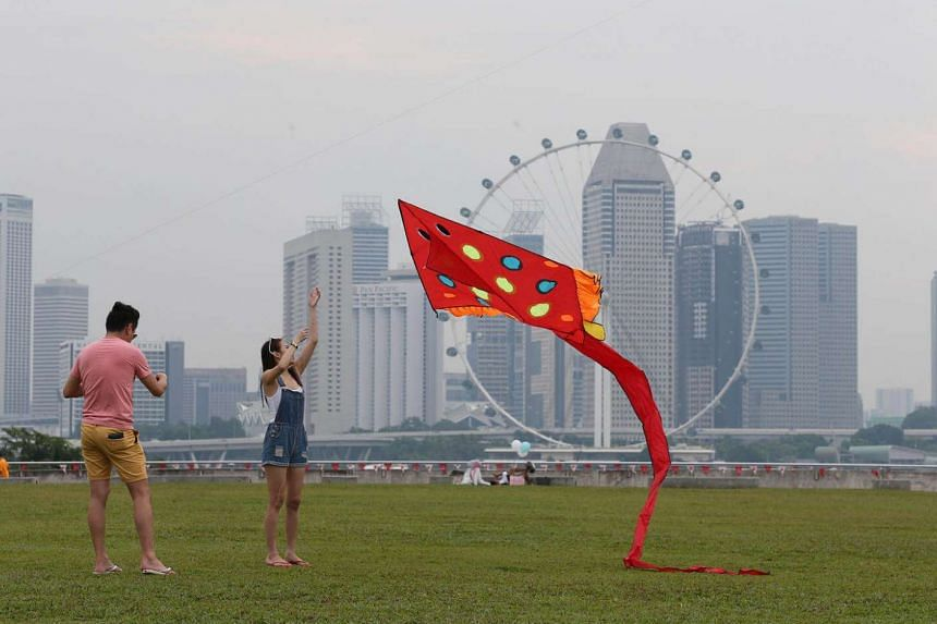 People were out and about at Marina Barrage at 5pm on Aug 27 despite hazy conditions.