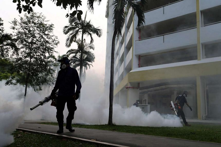 Workers fogging in the housing estate at Aljunied Crescent in Singapore on Aug 28, 2016.