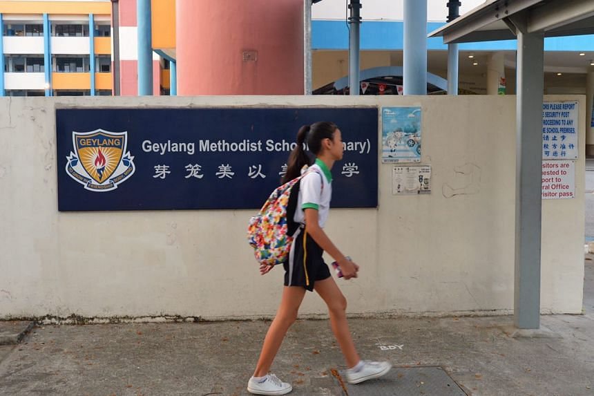 A student walks in front of Geylang Methodist Primary School on Aug 29, 2016.