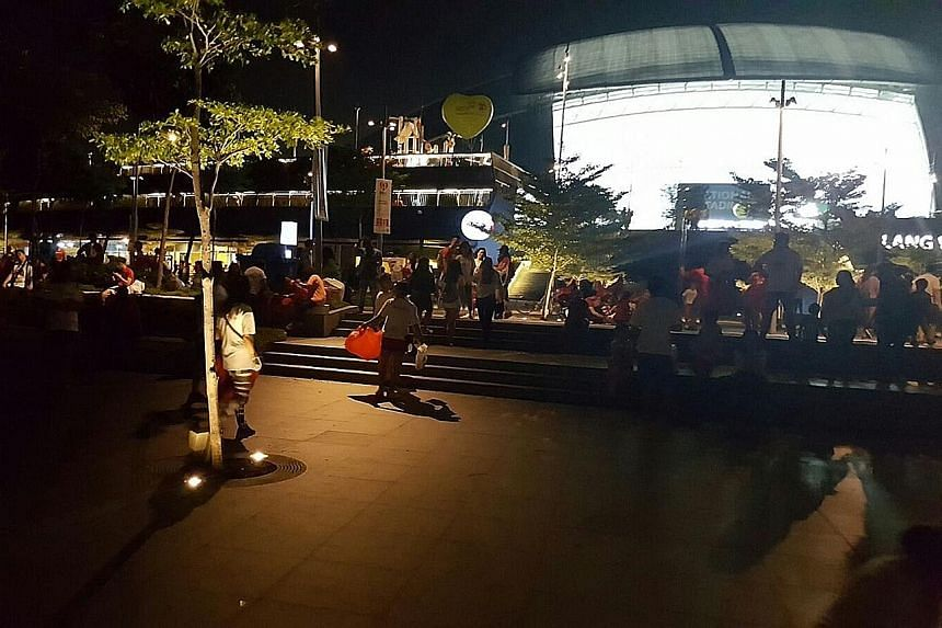 Many partygoers outside the National Stadium brought along their own trash bags, said a volunteer.