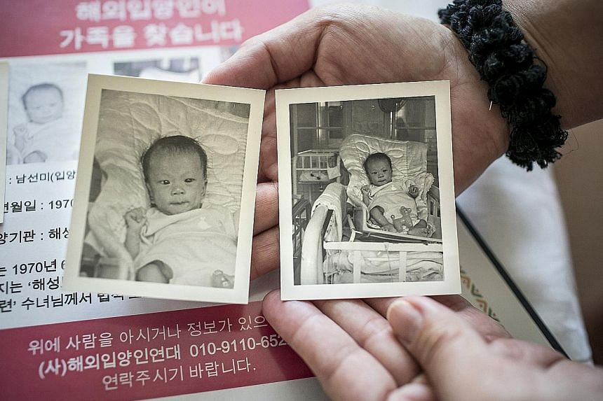 Ms Stapel showing baby photos of herself during a recent visit to Seoul, where she went to search for her birth parents. South Korea was once the world's leading exporter of babies, and every year, many return, looking for information about their pas