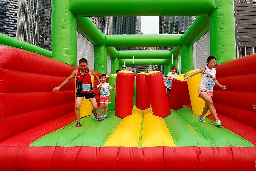 The giant inflatables in the 5km fun run were a hit with participants, and lines of between five to 10 people formed before each obstacle.