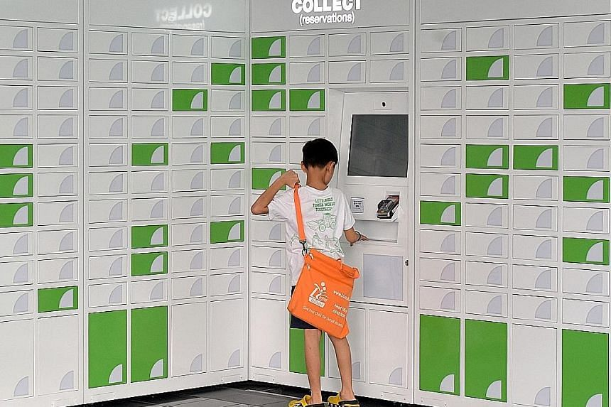 At self-service lockers, like this one at Jurong Regional Library, users can pay the reservation fee and collect the reserved item.