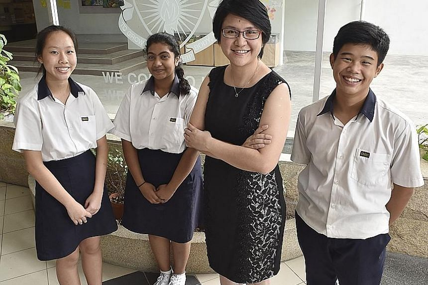 Geylang Methodist Secondary School senior mathematics teacher Wendy Wong with students (from left) Ng Shu Wei, Raziya Begum and Ulysse Yeo, all 15. Changing students' mindsets is no easy task, but Ms Wong says she does not give up easily.