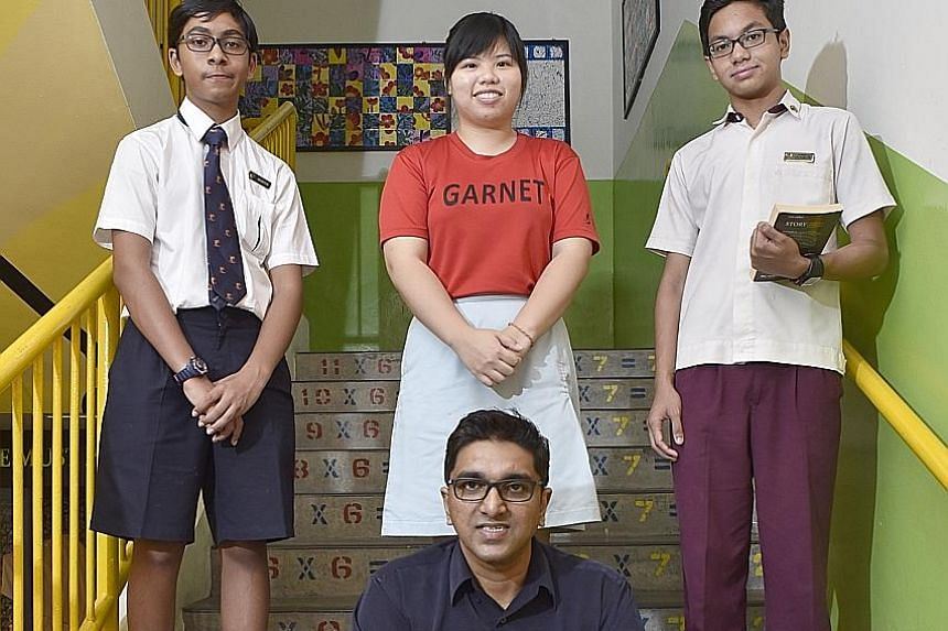 Mr Ravindran and three of his former pupils (from left): Theijes Menon, 13; Lee Chin Jing, 19; and Muhammad Firdaus, 14.