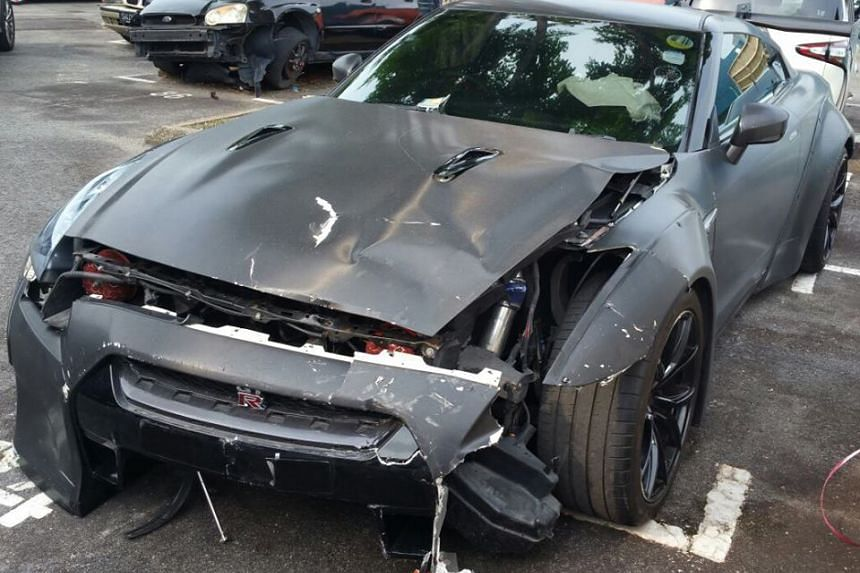 A Nissan GTR driven by the 18-year-old suspect crashed into a Toyota car at the open-space carpark near Stadium Road on Aug 27, 2016.