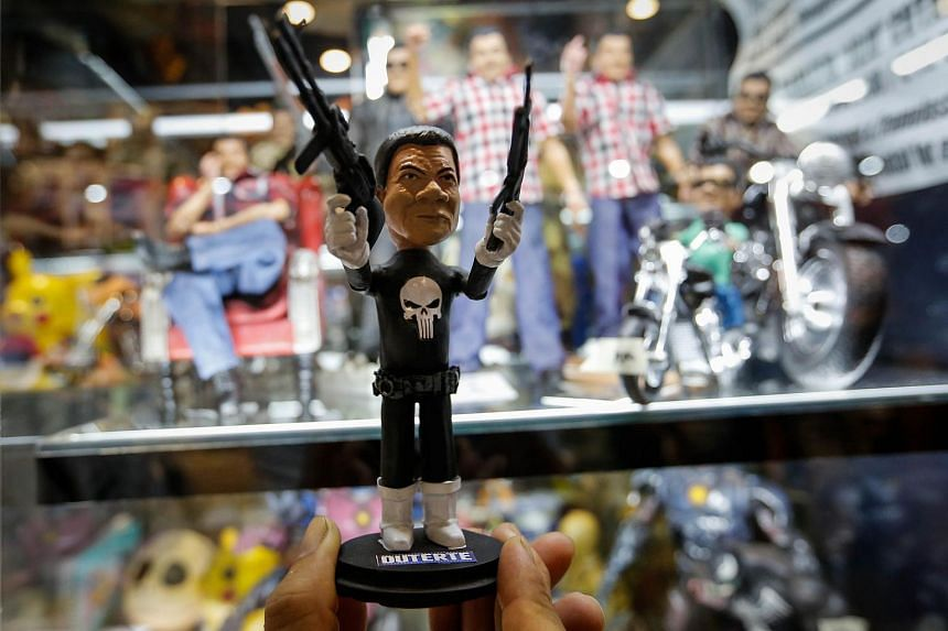 """A small figure depicting Philippine President Rodrigo Duterte as the character """"Punisher"""" is on display during the 2016 Asia Pop Comic Con in Pasay City, Philippines on Aug 28, 2016."""
