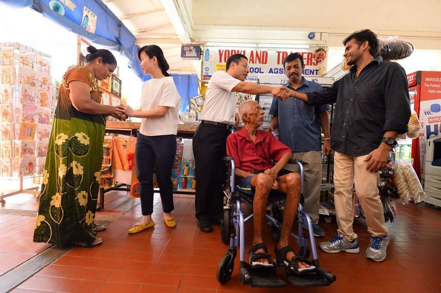 Senior Minister of State Desmond Lee and MP Tin Pei Ling visiting shopkeepers at Geylang East Neighbourhood Centre on Monday (August 29).