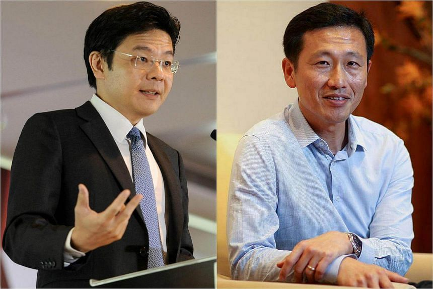 Minister for National Development Lawrence Wong (left) and Acting Minister for Education (Higher Education and Skills) and Senior Minister of State for Defence Ong Ye Kung.