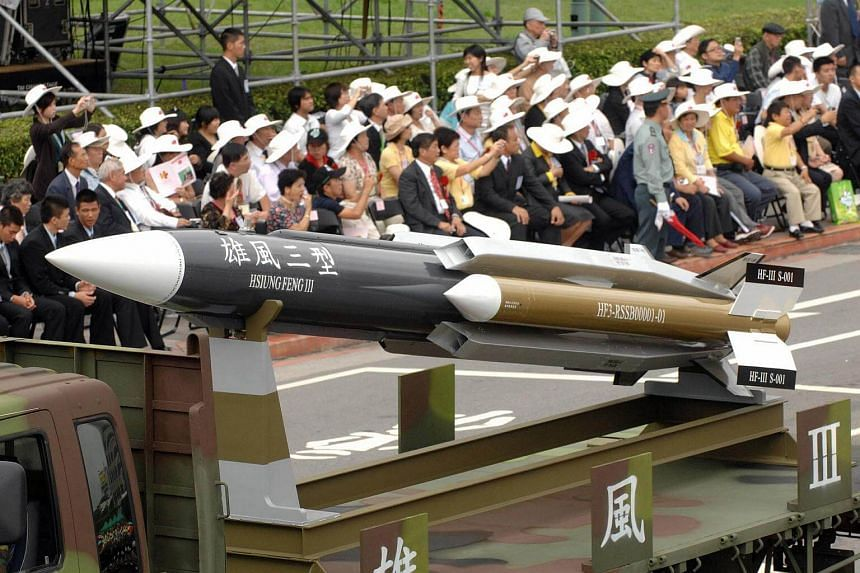 A model of a home-grown supersonic Hsiung-feng III (Brave Wind) ship-to-ship missile in Taipei during the first military parade in 16 years.