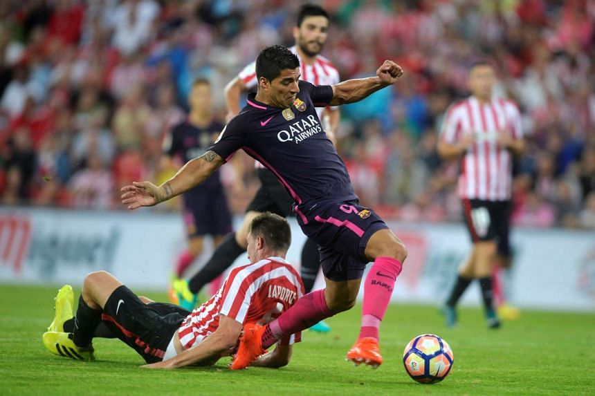 Athletic Bilbao's Aymeric Laporte (left) in action with Barcelona's Luis Suarez.
