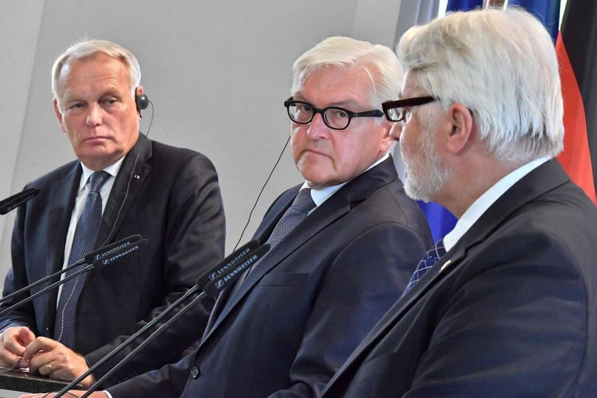 German Foreign Minister Frank-Walter Steinmeier (centre), French Foreign Minister Jean-Marc Ayrault (left) and Polish Foreign Minister Witold Waszczykowski (right) give a press conference  at Ettersburg castle on Sunday (Aug 28).