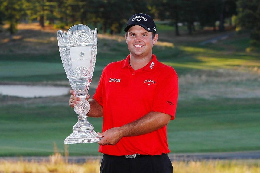 Patrick Reed poses with the trophy after winning The Barclays on Aug 28, 2016 in Farmingdale, New York.