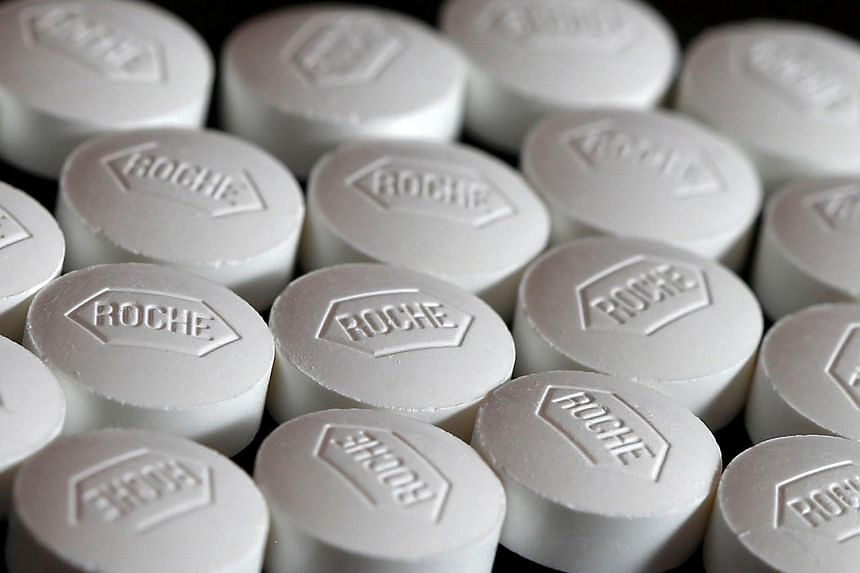 A photo illustration of Roche tablets.