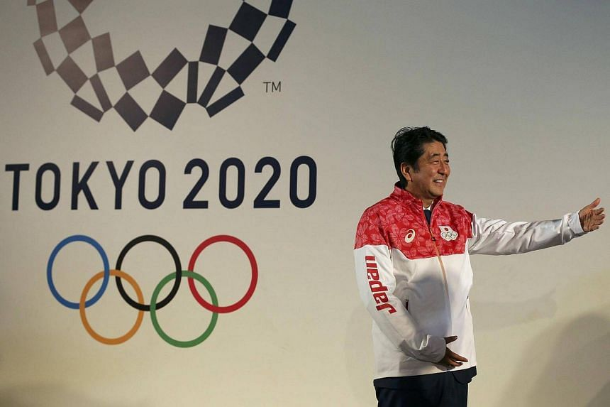 Japanese PM Shinzo Abe visits the Japan House to greet his country's Olympic athletes and delegates, in Rio de Janeiro August 21.