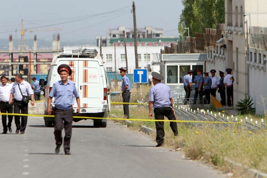 Investigators, Interior Ministry officers and security forces working near the site of a bomb blast outside China's embassy in Bishkek, Kyrgyzstan, on Aug 30, 2016.