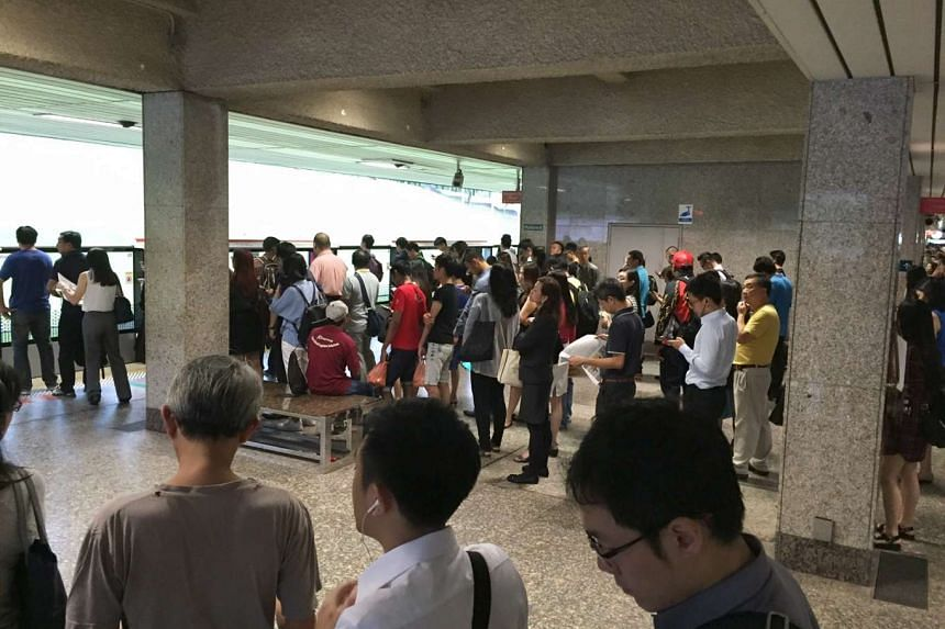 Commuters waiting for a southbound train at 7.50am at Ang Mo Kio station on the North-South Line, which was hit by a track fault on Tuesday morning (August 30).
