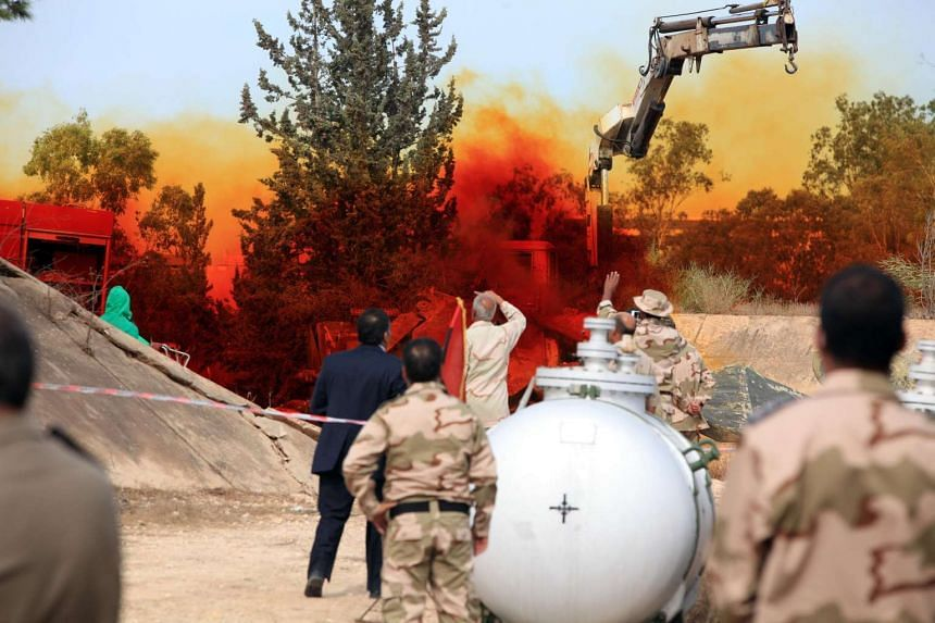 Libyan experts and military engineers monitoring a dump tank, used to dispose of toxic chemicals, under the supervision of UN officials on Nov 11, 2012.
