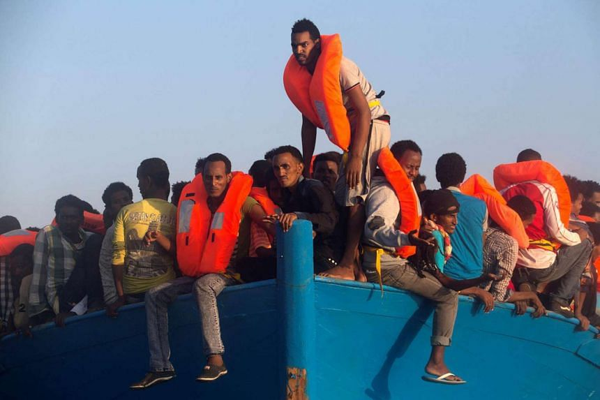 Migrants from Eritrea are seen on an overcrowded wooden vessel during a rescue operation by the Spanish NGO Proactiva on Aug 29.