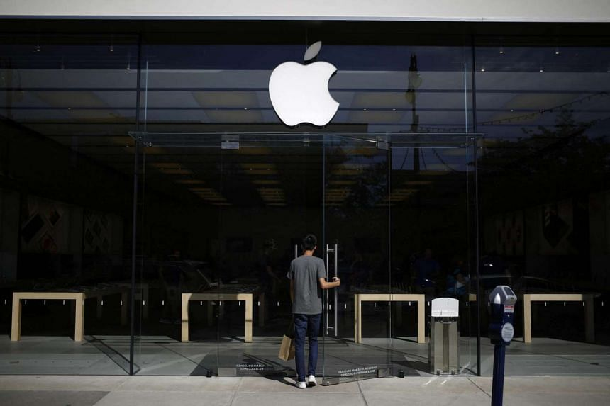 A shopper enters an Apple Inc store at the Easton Town Centre shopping mall in Columbus, Ohio, US, on Aug 23.