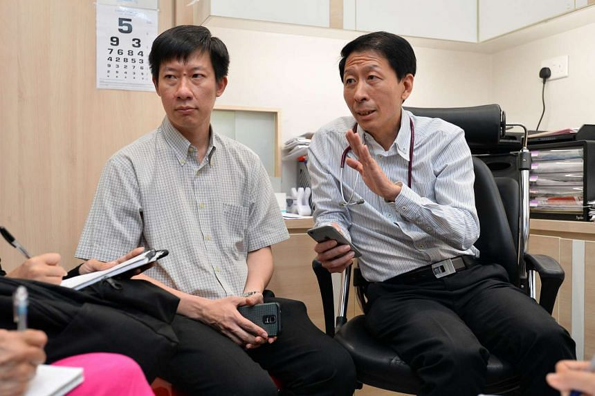 Dr Chi Wei Ming (left) and Dr Lim Chien Chuan and their colleagues are used to discussing cases with one another. It was this habit that helped uncover the outbreak in Singapore.