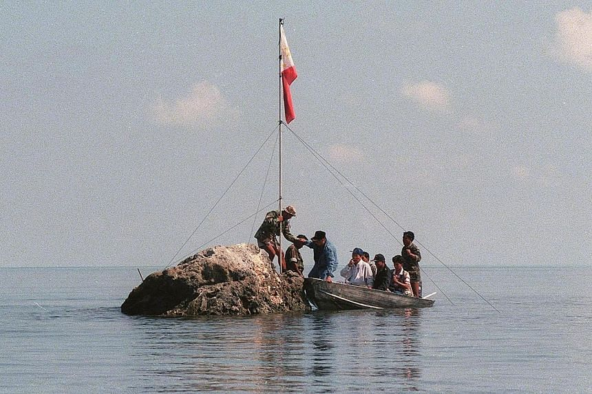 A Philippine team on Scarborough Shoal on May 17, 1997.