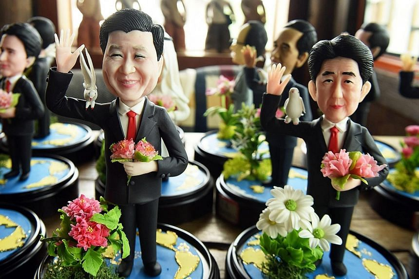 Dough figurines of G-20 leaders, including Chinese President Xi Jinping (forefront, left) and Japanese Prime Minister Shinzo Abe, made by craftsman Wu Xiaoli for the upcoming summit in Hangzhou, Zhejiang province. The 11th G-20 Leaders Summit will be
