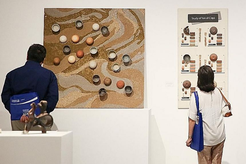 The National Institute of Education's exhibition of Iskandar Jalil's works includes a segment on different types of local clay, which the potter uses.